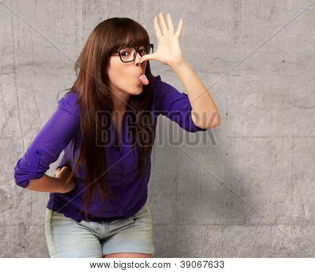 Crazy Woman With Stick Out Tongue On Wall