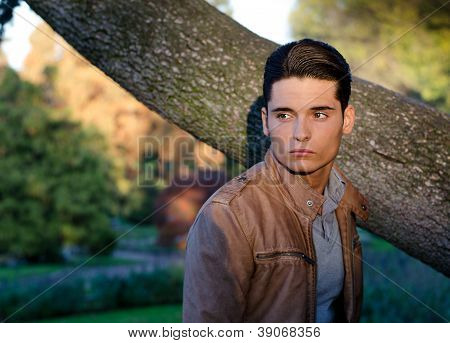 Attractive young male model outdoors in nature