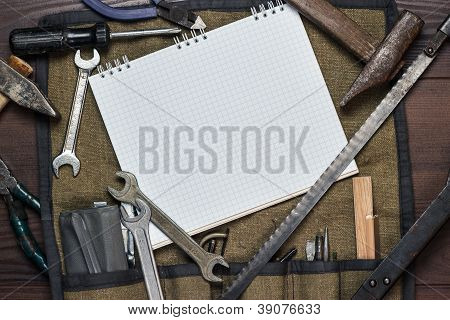 Construction Tools And Blank Notepad