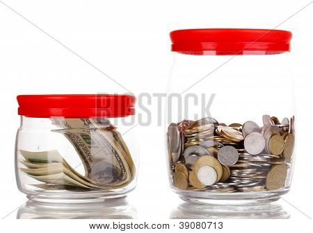 Clear glass jars for tips with money isolated on white