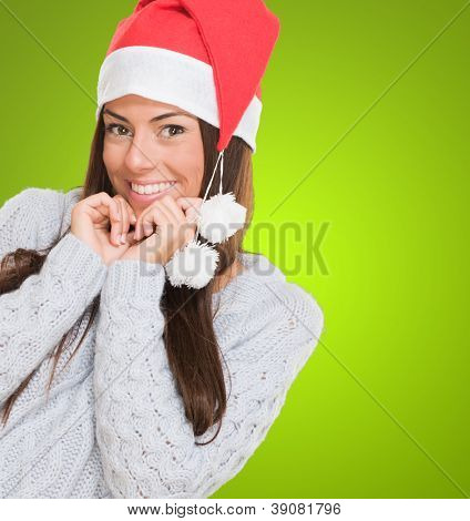 Portrait of a christmas woman smiling against a green background