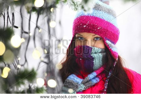 woman in winter hat and holyday bokeh