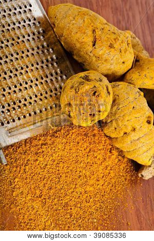 Turmeric curcuma root and powder with steel hand grater