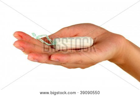 woman's hand holding a clean cotton tampon on white background close-up