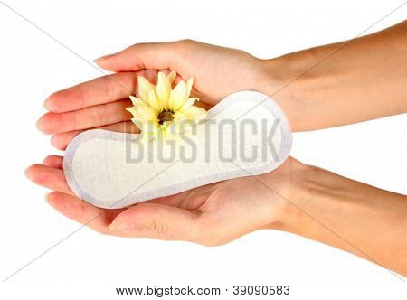 woman's hands holding a daily sanitary pad on white background close-up