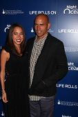 LOS ANGELES - NOV 11:  Kalani Miller, Kelly Slater arrives at the Life Rolls On Foundation's 9th Ann