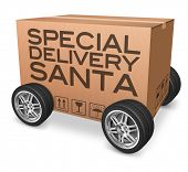 special delivery Santa Claus Christmas presents in cardboard box on wheels