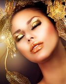 Fashion Glamour Makeup. Glamor Golden Make-up.Holiday Gold Makeup
