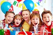 stock photo of schoolgirls  - Group of adorable kids looking at camera at birthday party - JPG
