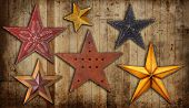 stock photo of iron star  - Vintage Christmas star collection on a wooden background - JPG