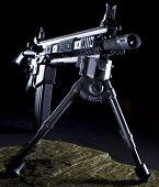 stock photo of ar-15  - Modern assault rifle with a bipop ready for a long shot from the dark - JPG