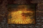 Vitruvian Man and Human Eye image on a brick wall background.