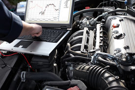 picture of combustion  - Professional car mechanic working in auto repair service - JPG