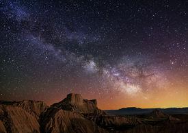 stock photo of sagittarius  - Milky Way over the desert of Bardenas Spain - JPG