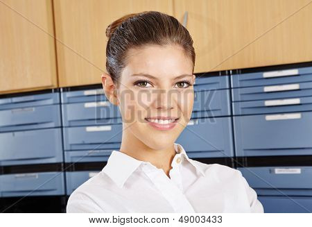 Young smiling receptionist working at the reception in a hospital