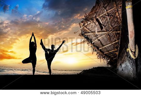 Yoga Silhouettes On The Beach