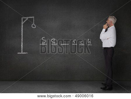 Thinking businessman playing at hangman game
