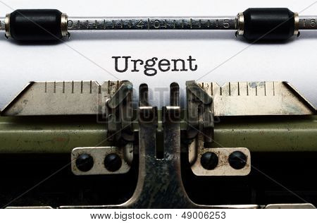 Urgent Text On Typewriter