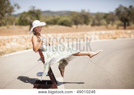 caucasian young woman is on a road