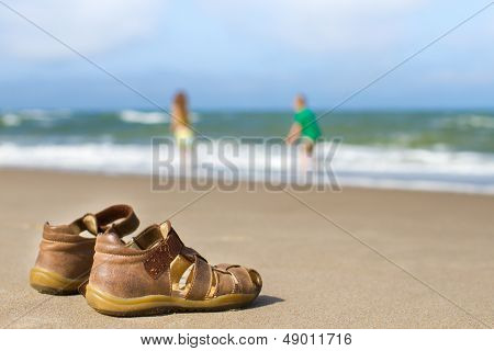 Kid Sandals With Blurred Boy And Girl