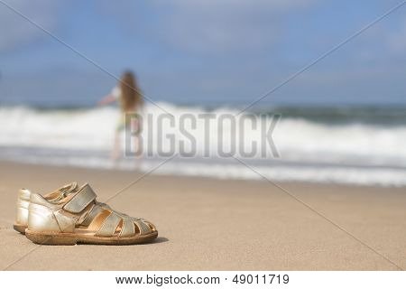 Girls Sandals On Sand At Beach