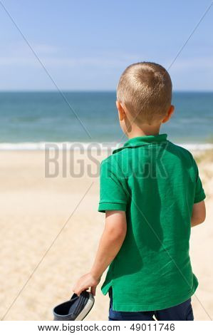 Boy With Panonamic View Of North Sea Beach