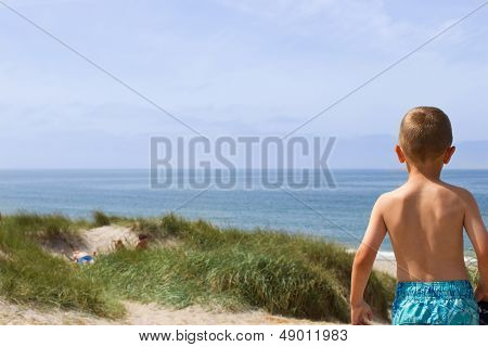 Boy Overlooking The North Sea Coastline