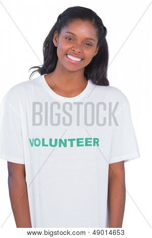 Smiling young woman wearing volunteer tshirt on white background