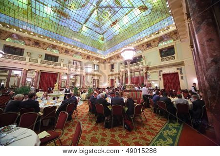 MOSCOW - DEC 4: People in suits eat at an expensive restaurant Metropol with chic interior on December 4, 2012 in Moscow, Russia.