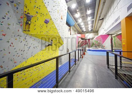 MOSCOW - DEC 5: Men involved in climbing in a climbing gym Bigwall on Savelovskaya on December 5, 2012 in Moscow, Russia.