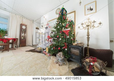 Christmas tree and fireplace in the living room decorated for the new year
