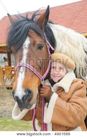 Pretty Grandmother Near Horse