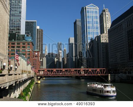 Ferry traveling downtown Chicago River