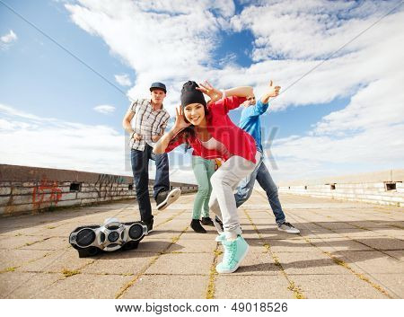 sport, dancing and urban culture concept - group of teenagers dancing