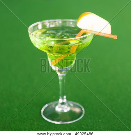 apple margarita cocktail on green background