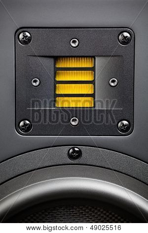 yellow tweeter - high-frequency loudspeaker, closeup