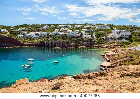 Cala Morell cove scenery in sunny day at Menorca, Spain.