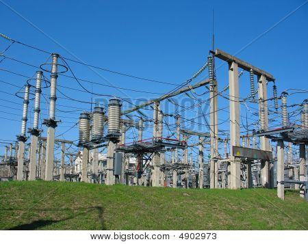 High-voltage Substation On Blue Sky Background With Switch And Connectors