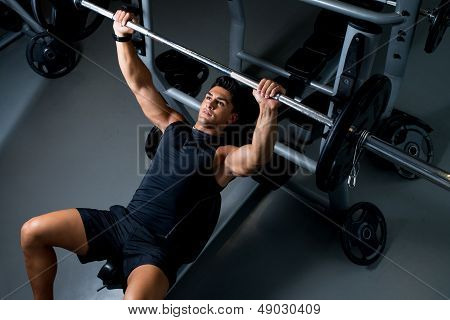 Young Man Working Out In The Gym