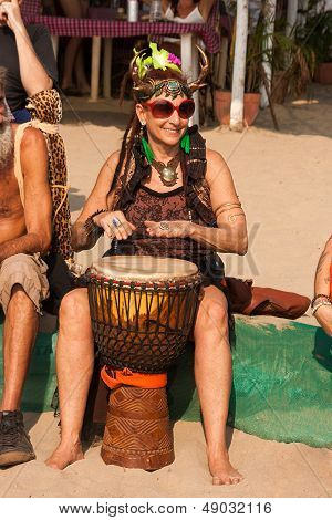 An Unidentified Woman In Carnival Costume Plays The Djembe Drum At