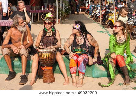 Arambol, Goa - February 5, 2013: Unidentified People In Carnival Costumes Sit, Talk, Play The Djembe