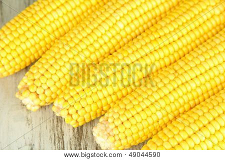 Crude corns on wooden table