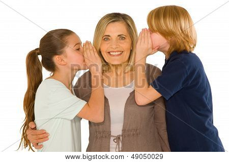 Young Grandmother With Nephew And Niece Standing On White Background