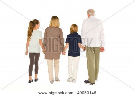 Young Grandmother Grandfather With Nephew And Niece Standing Back On White Background
