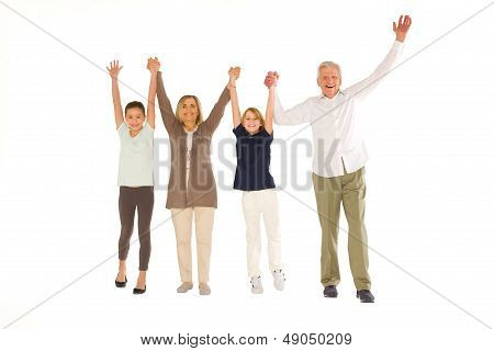 Young Grandmother Grandfather With Nephew And Niece Standing Arms Up On White Background
