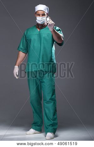 Caucasian Mid Adult Male Doctor Wearing A Mask