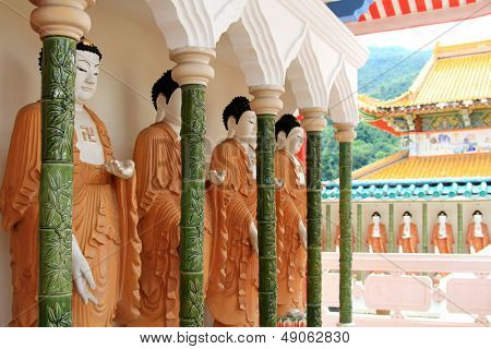 Rolls of Mahayana-styled Buddhas along the Cloister at the Buddhist Temple of Supreme Bliss : Kek Lok Si, Penang, Malaysia