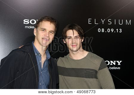 LOS ANGELES - AUG 7:  Luc Robitaille, Steven R. McQueen arrives at the