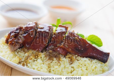 Peking duck or Roasted duck, Chinese style, served with steamed rice on dining table. Hong Kong cuisine.
