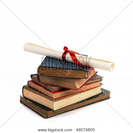 Diploma with old book isolated  on a white background.